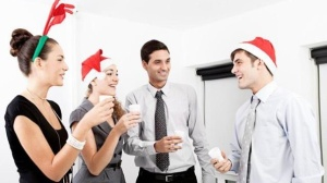 office-holiday-party-workers-in-Christmas-hats-jpg